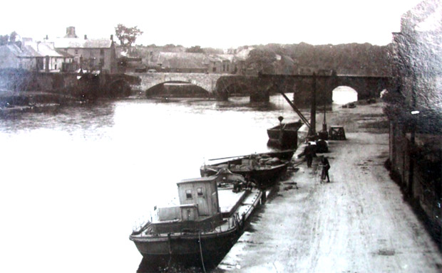 Knocknagow, lighters and gantry on the quay early 1900's