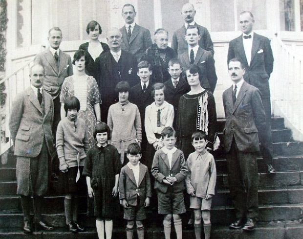 Back Row: Joe, Milo & Jack. 4th Row: Francis, Mary Quirk, Edward, Ursula & Arthur 3rd Row: Florence, Cecil, & Edward (Dow). 2nd Row: Louis, Betty, Joan, Mimi, Mary Bacon & Willie Front Row: Marjorie, Edric, Ian & Dermot